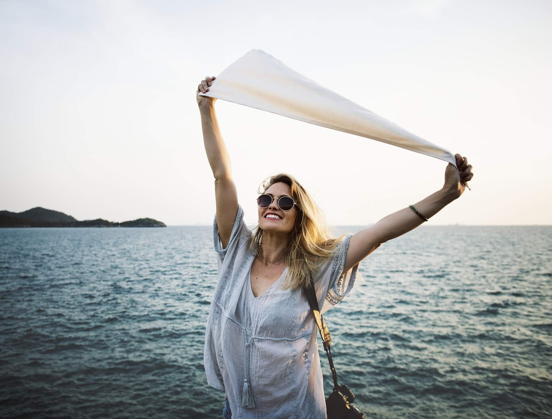 A woman with arms stretched wide: How to live generously