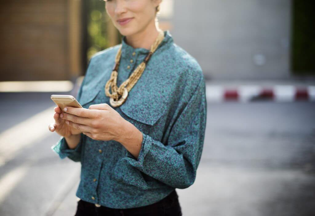 Woman with phone: when to say no to your boss