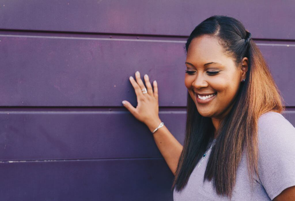 Smiling woman: How to ask for help without being needy