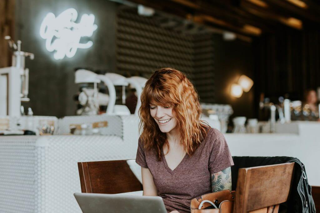 Woman with laptop. Can you do coaching certification online?