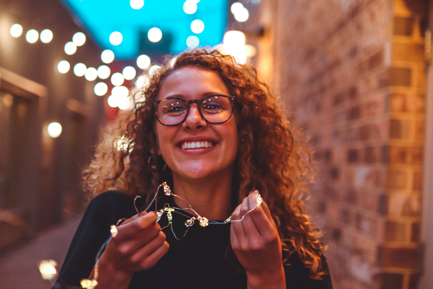 Woman smiling at a party: But why are resolutions so hard to keep?