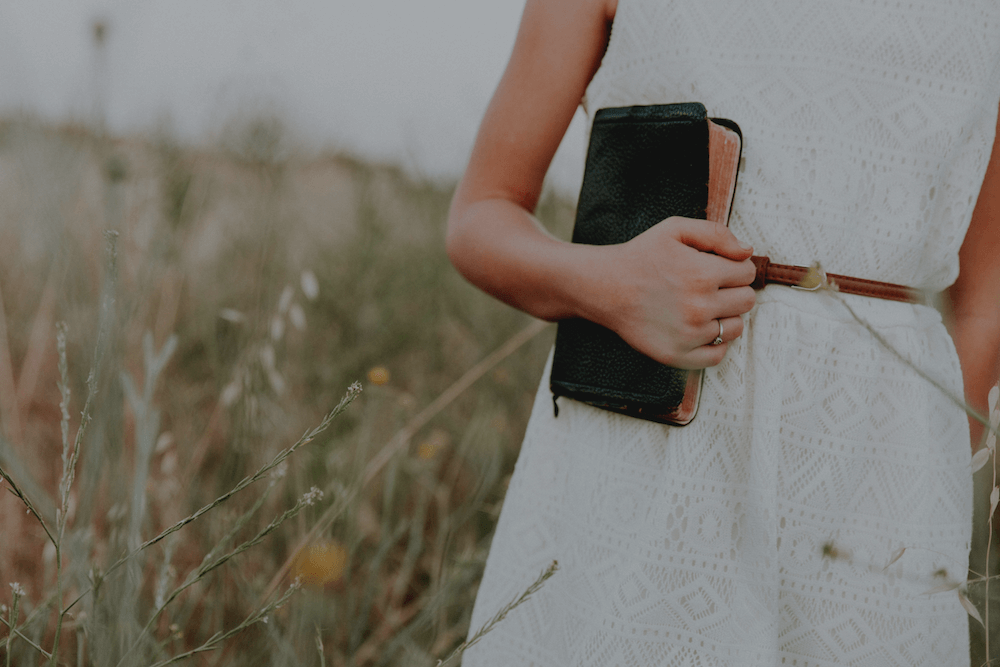 Woman holding purse: The Inner Game of Money