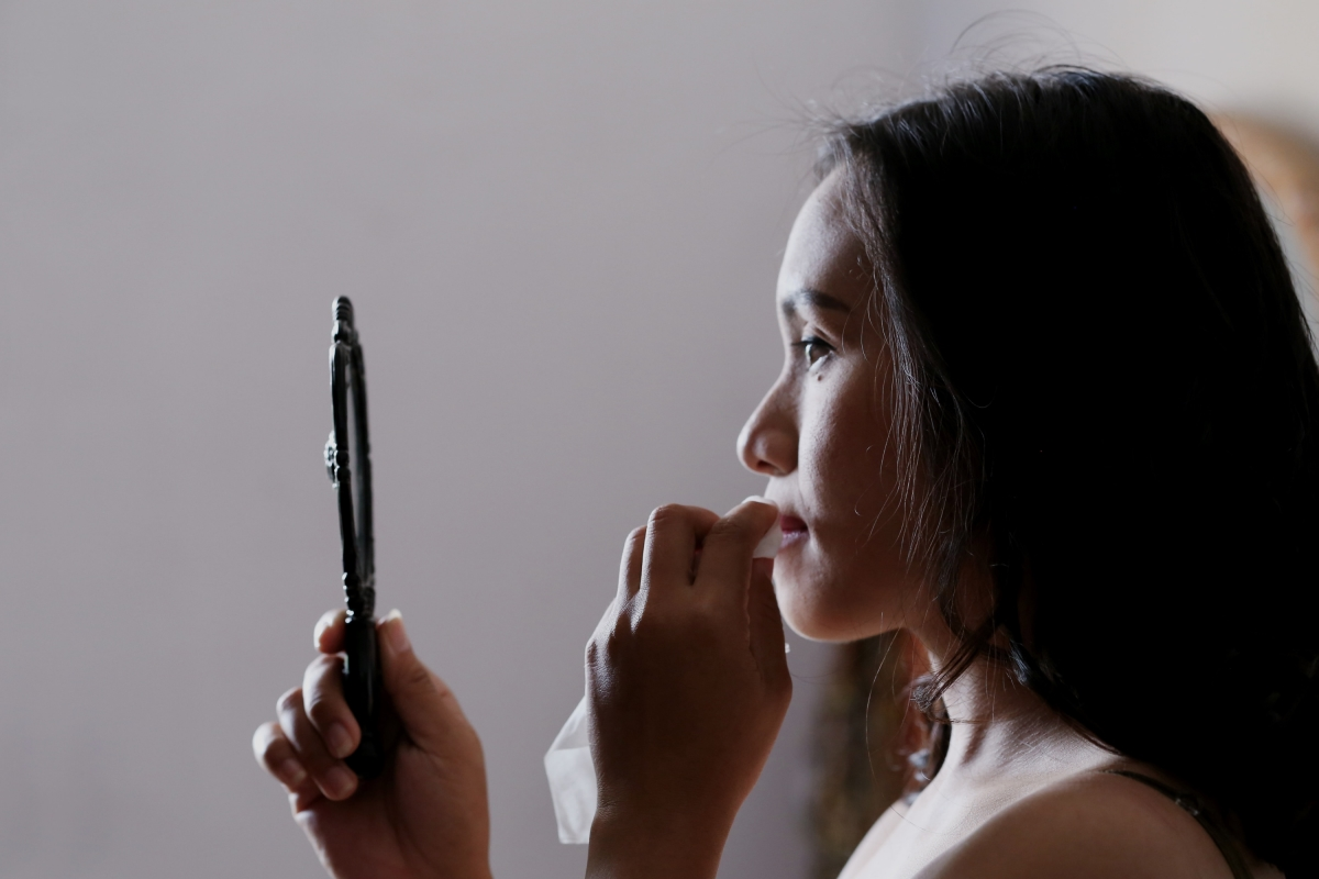 Woman looking in mirror. Selfish or selfless? Why self-examination is important