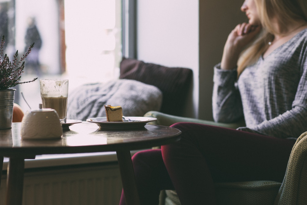 Woman in cafe: The most important question to ask yourself