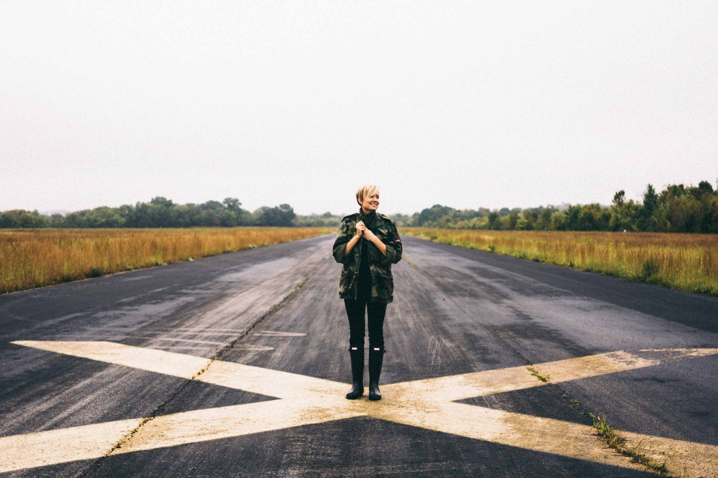 Woman standing on big painted cross: how to handle your inner critic