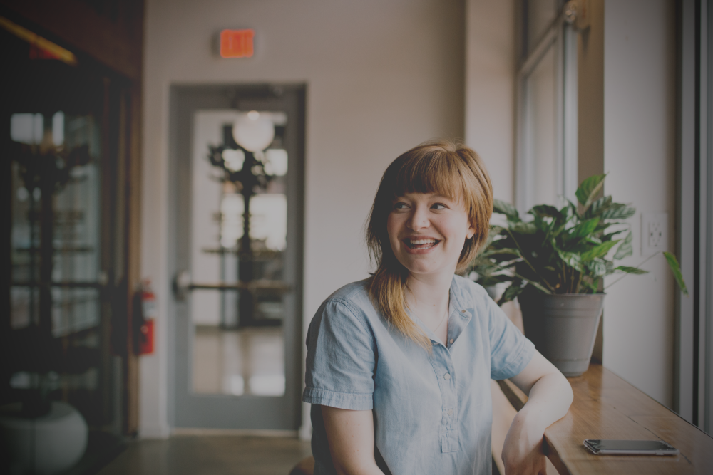 Woman next to plant: A surpising way to boost your leadership