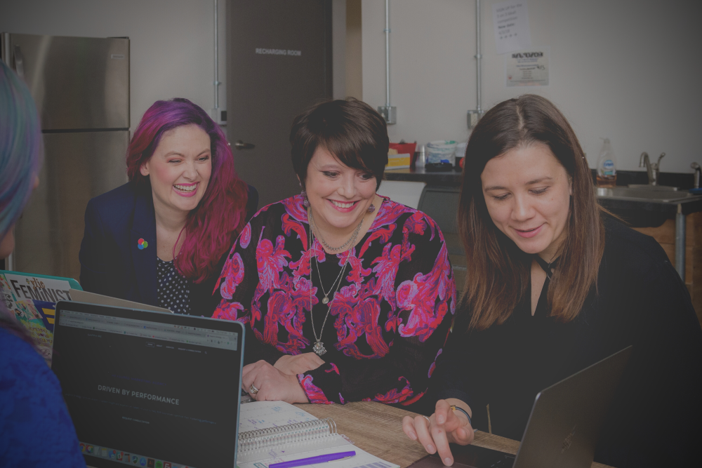 Women smiling in the workplace: How to boost your team's wellbeing