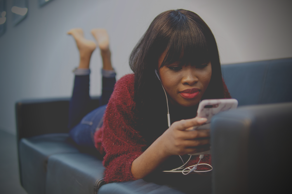 Woman looking at phone: The high-achiever's guide to letting go